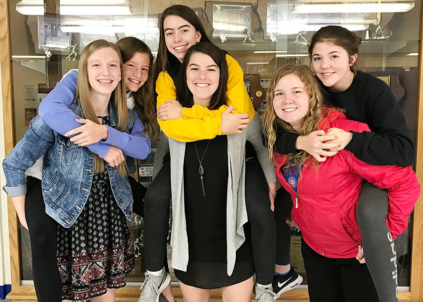Wilton's 2018 state volleyball team features three sets of sisters (from left) Kortney and Kelsey Drake, Emily and Mallory Lange, and Taylor and Alexa Garvin.