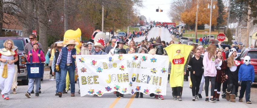 One of the longest running traditions in the North Scott School District continued on Wednesday (Oct. 31) when students at John Glenn Elementary took to the streets of Donahue for the community's annual Halloween Parade. The banner that led the parade proclaims the school's theme for the school year.