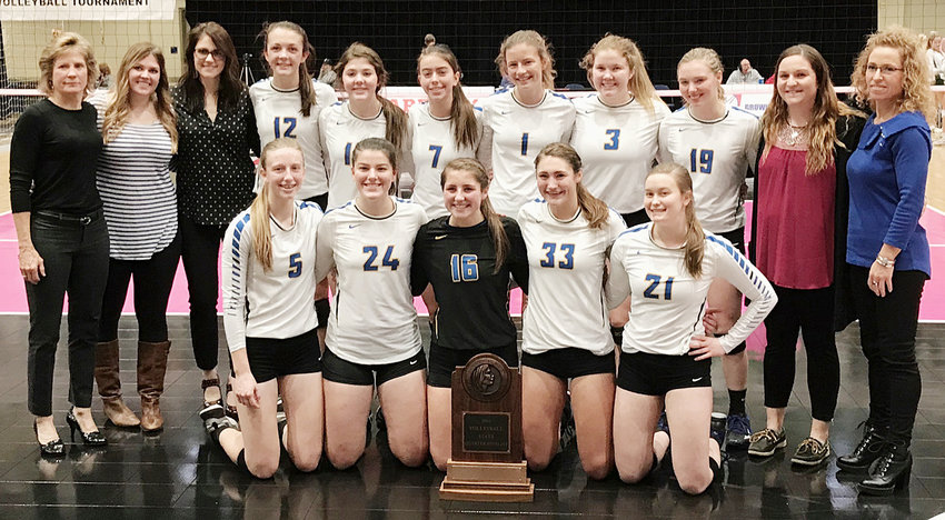 The 2018 Wilton volleyball team made its fourth ever state tournament appearance after defeating Class 2A No. 1 ranked Grundy Center to qualify. In opening round state action Nov. 7, the 2A No. 8 seeded Beavers were defeated by top seeded Dyersville Beckman 25-21, 25-13, 25-17. See pages 10-11 for coverage. Pictured above with the state participation trophy include (front from left) Kortney Drake, Emily Lange, Eleney Owens, Aubrey Putman and Becca Ball; back row, head coach Brenda Grunder, assistant coaches Carlee Grunder and Kayla Byington, Ella Caffery, Alexa Garvin, Mallory Lange, Kelsey Drake, Taylor Garvin, Peyton Souhrada, assistant coaches Kelly Jo Jannings and Angela Voss Dann.
