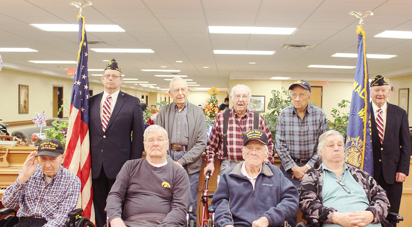 Members of the Walcott American Legion Post 548 joined the Wilton Retirement Community staff to hold a Veterans Day service on Monday, Nov. 12. Veterans honored included: (front row from the left) Bill Paulsen, who served in the U.S. Army during World War II; Duane Meyer; Lee Hocke, who served in the U.S. Army in World War II; David Scieszinski; (back row) Brian Mengler of Post 548; Dale Thumma, who served un the U.S. Army during the Korean War; Richard Stammer, who served in the U.S. Army from 1944-1946; Jack Henderson, who served in the U.S. Navy in World War II; and Lee Muller of Post 548. The service honored Robert Schlapkohl, who served in the Korean War from 1953-1954 and was present but not pictured. Craig Gheer, who served in the U.S. Navy during Vietnam, and Maurice Jones, who served in the U.S. Navy in 1943, were honored but not present. The late Ed Williams who served in the U.S. Navy from 1946-1948 was also honored with a moment of silence.