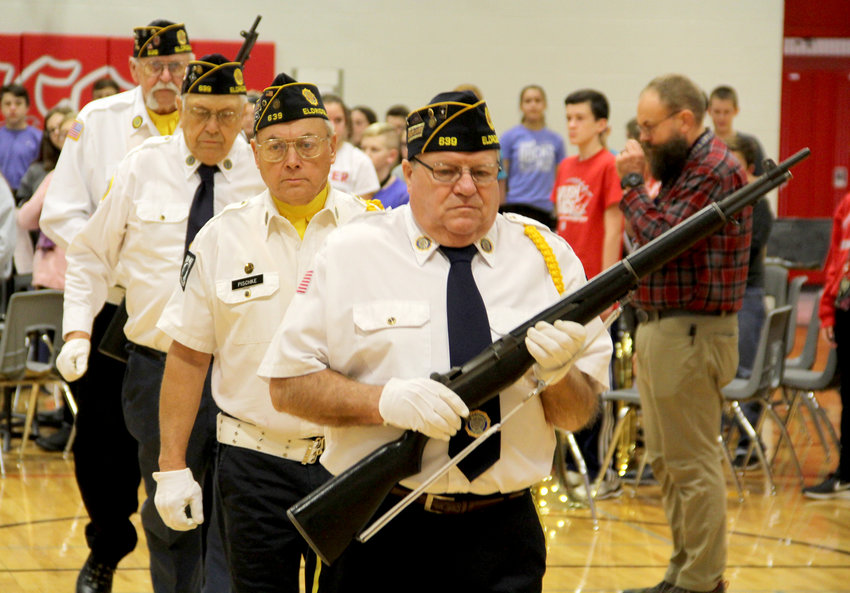 An American Legion color guard opens the junior high ceremony.