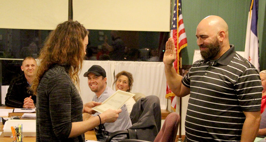 Broad smiles from Long Grove council members greet new council appointee Brandon Cronise as he is sworn in Nov. 13 by city clerk Rose Boddicker.