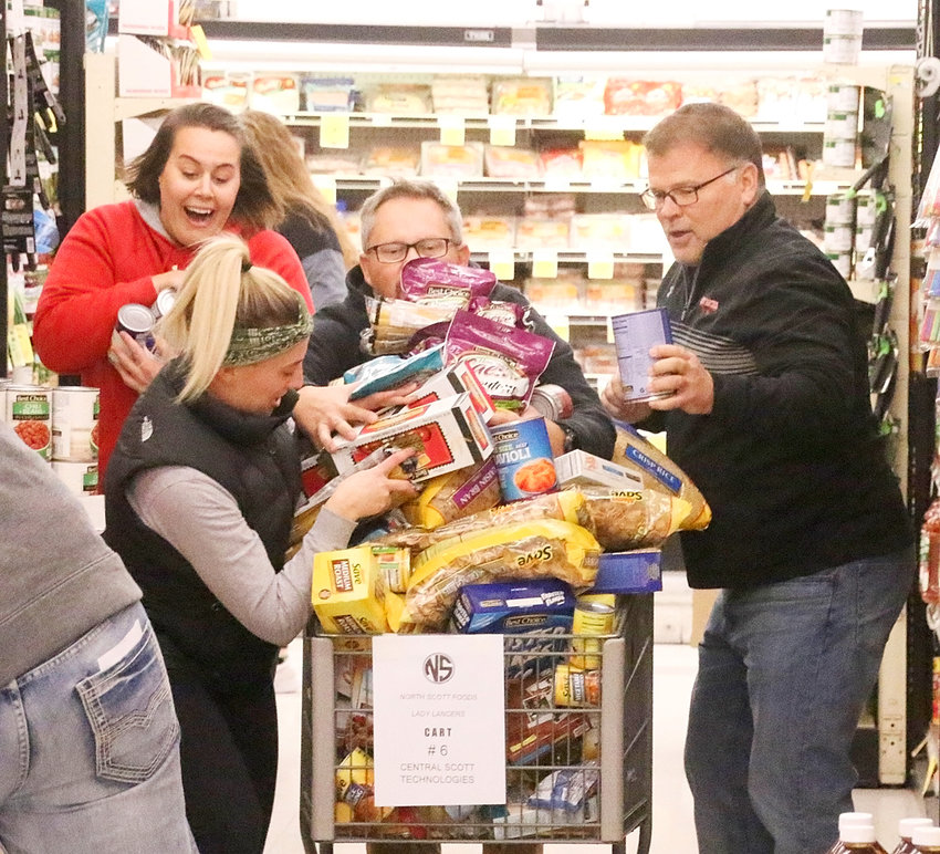 The North Scott coaching staff's cart overfloweth with goodies as it headed for the checkout line. From left: Devyn Rolston, Ashley Dexter, TJ Case and Todd Satterly.