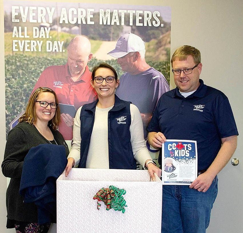 Employees at River Valley Cooperative's Mt. Joy location are eager to fill their decorated donation box with warm winter coats, hats, scarves, and mittens for area children. Pictured (l-r) are Lindsey Tiemessen, Bridgett Wildermuth, and Dustin Hoeft.
