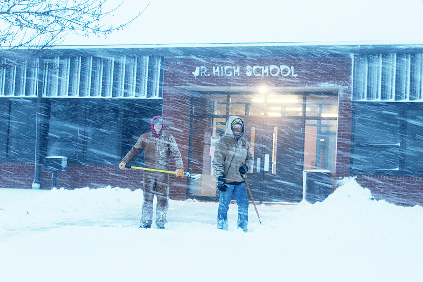 With 12.5 inches of snow recorded in Wilton on Sunday, it was no surprise that area community events and classes were cancelled. Two people can be seen attempting to clear snow from the junior high entrance at Durant schools late Sunday afternoon. Parents in Wilton and Durant would later receive a message from Superintendent Joe Burnett announcing the cancellation of classes for Monday, Nov. 26.