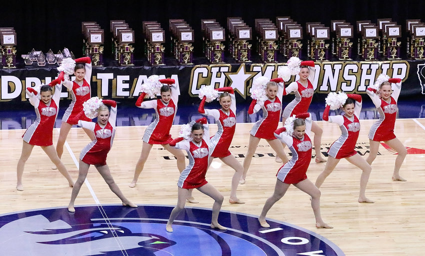 North Scott's Silver Shakers were happy with their second-place finish in the Class 12 Pom division. From left: Megan Sacia, Carley Youngquist, Kenedy Bender, Olivia Wessel, Mallory Loussaert, Abby Lundvall, Hannah Bain, Dana Gehrls, Sophie Clydesdale, Lily Kain and Elsa Treiber.