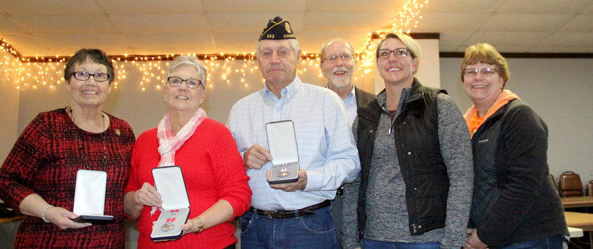 Larry Gronewald's family members pose with the slain Vietnam War soldier's medals, presented by Rep. Dave Loebsack in a moving ceremony Sunday at Don's Pub in Donahue. From left: Sisters Arlene Kaczinski and Linda Holdorf, brother Ralph Gronewald, Loebsack, nieces Carrie Coon and Chris Arp.