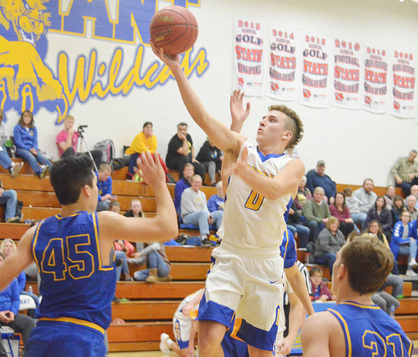 Durant's Mason Compton (middle) skies to the hoop for a layup in a home 72-44 win over Wilton Dec. 4. The Wildcats earned a Backyard Challenge point in the process. This year's challenge is tied 5-5.