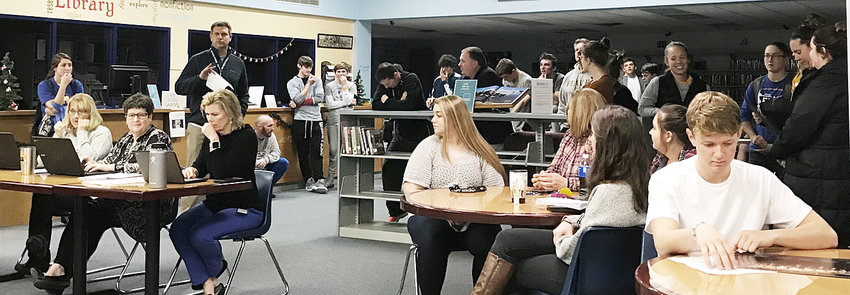 """Several Wilton High School athletes and coaches filled the media center for the district's annual """"Parade of Champions"""" event where coaches report to the school board on the happenings of the various Wilton sports and extra-curricular activities throughout the year."""