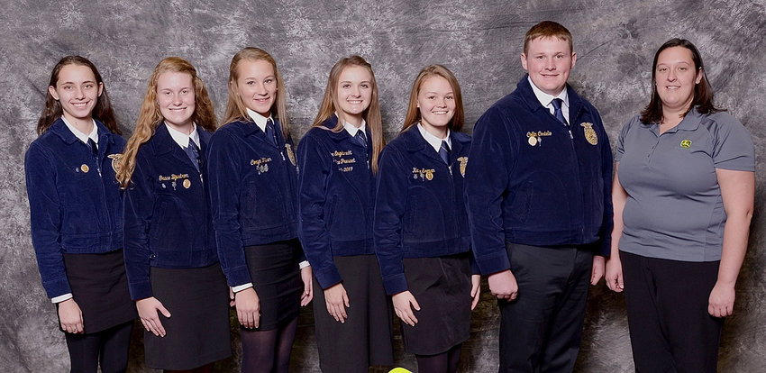 Representatives of the 2017-2018 Chapter Officer Team meet with a representative of John Deere,  the national sponsor. Pictured (l-r) are Kelly Hermiston (Parliamentarian), Grace Bjustrom (Sentinel), Coryn Wilson (Reporter), Chloe Engelbrecht (Reporter), Katie Seeman (Secretary) and Collin Costello (President).