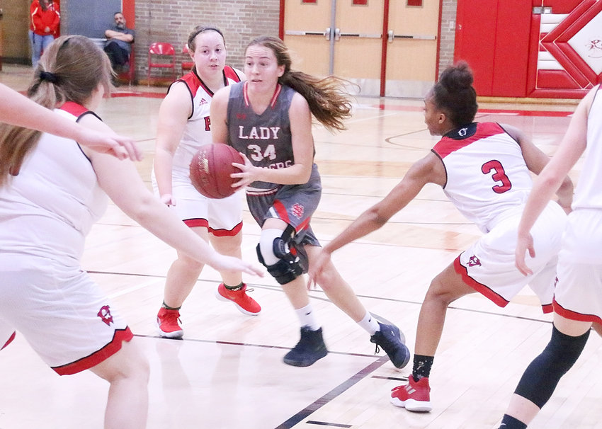 The Lancers pretty much had their way with Davenport West on Tuesday (Dec. 18), as evidenced by the way that senior Chloe Engelkes sliced through these three Falcon defenders.
