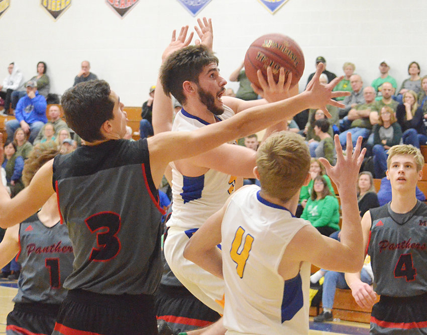 Marcus Engstler puts up a shot in traffic vs. Monticello.
