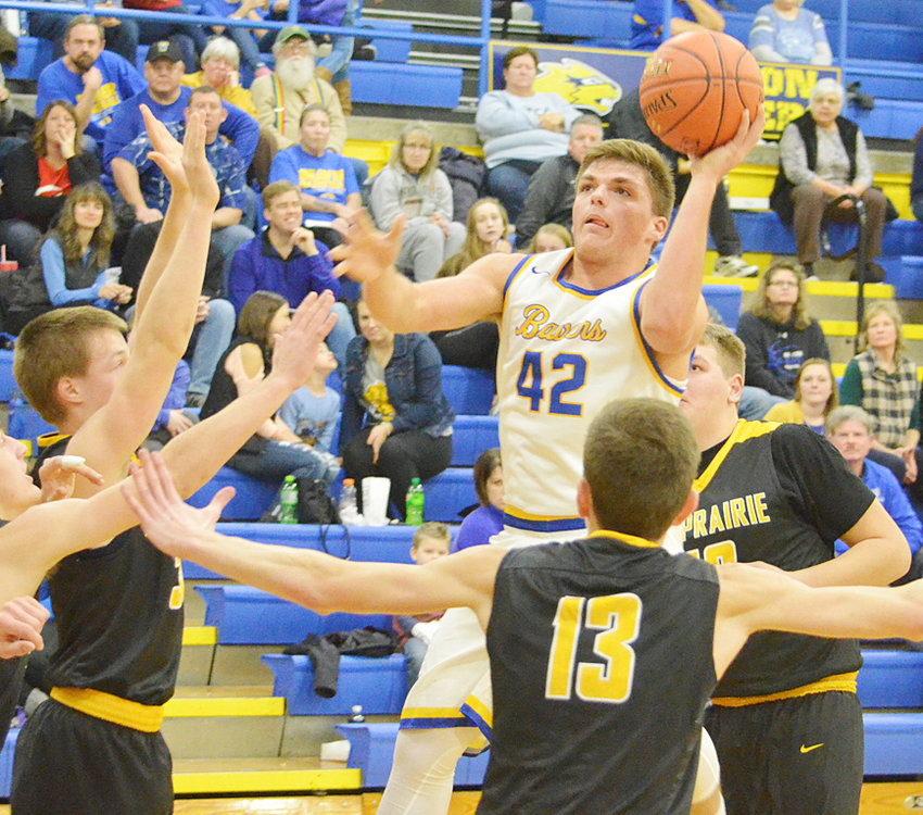 Jared Townsend puts up a shot in traffic against Mid-Prairie.