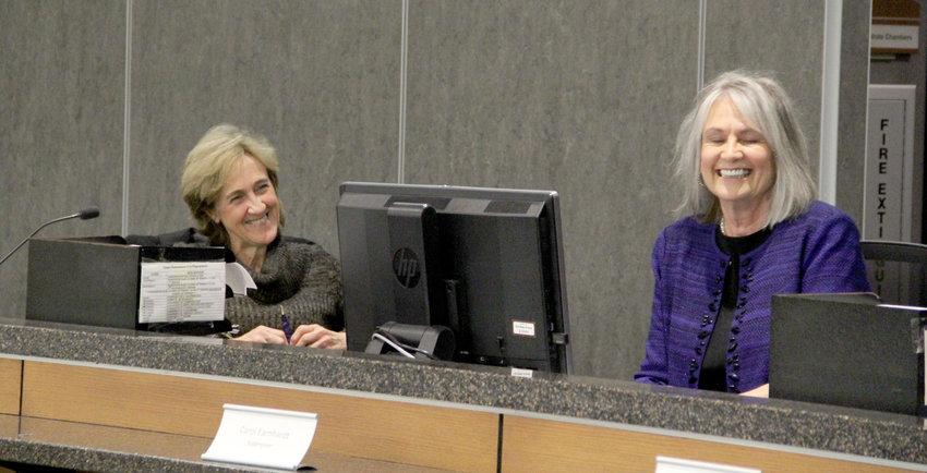 Diane Holst, left, and Carol Earnhardt shared thanks Thursday at their last Scott County Board of Supervisors meeting.