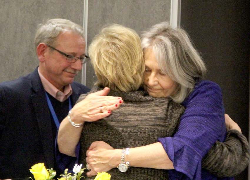 Holst and Earnhardt embrace Dec. 27 at their final board meeting.