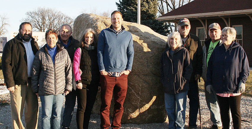 """Freedom Rock artist Ray """"Bubba"""" Sorensen II visited Wilton Dec. 18 to see the Muscatine County Freedom Rock, located near the Wilton Depot. He also met with Wilton Mayor Bob Barrett and the committee charged with landscaping and aesthetics in the area surrounding the rock, which as delivered in April. The Wilton Legion Auxiliary was instrumental in Wilton getting the bid for the rock and Sorensen will likely paint it with a patriotic theme in 2019. Pictured above (from left) include Jeff Kaufmann, Becky Hansen, Bob Barrett, Becky Allgood, Ray """"Bubba"""" Sorensen II, Cindy Tietz, George Leggins, Roger Bender and Mary Bollinger."""