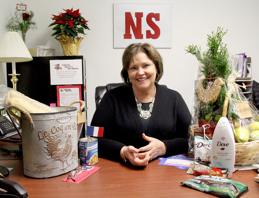 Mary Anne Braden poses in her high school office during her last week of work after 20 years with the district.