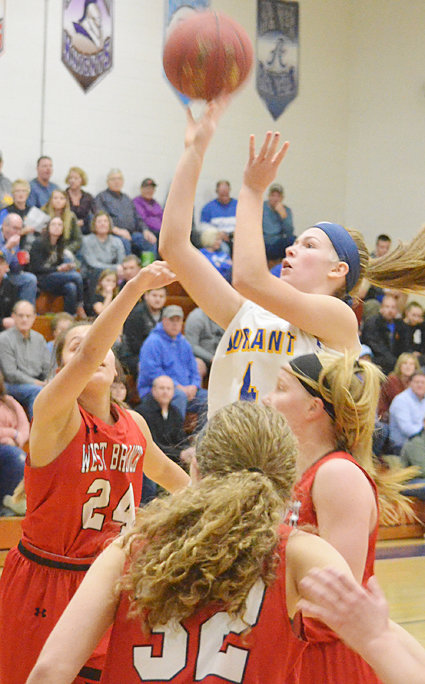 Durant freshman Ally Happ (at right) is shown shooting a jumper in the lane at home against West Branch Jan. 11. She went down with a foot injury and was forced to sit throughout the second half of a 42-29 loss.