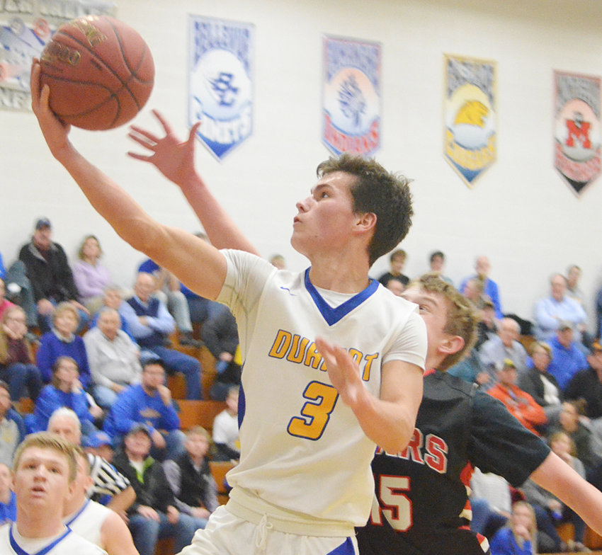 Easton Botkins skies to the hoop for a layup in home action against West Branch.