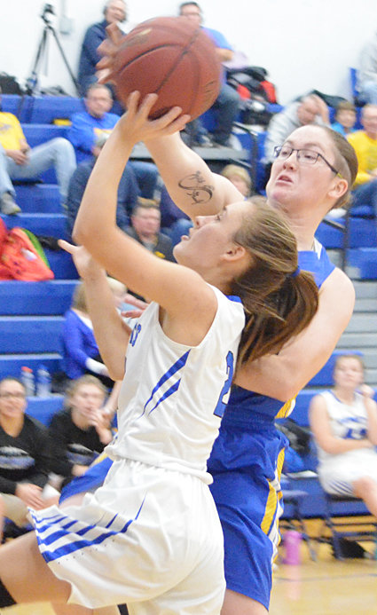 Wilton's Chloe Wells blocks the shot of West Liberty's Haylee Lehman in road action Jan. 8.