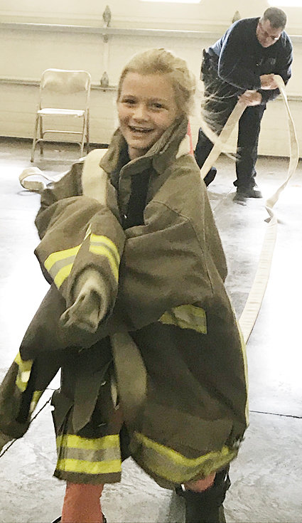 Durant third and fourth grade students were able to visit the Durant Fire Department in October to learn about fire safety. Students were also able to interact with uniforms and some equipment used by the department. Third grader Peyton Schroeder is shown above wearing a firefighter's jacket and handling a fire hose.