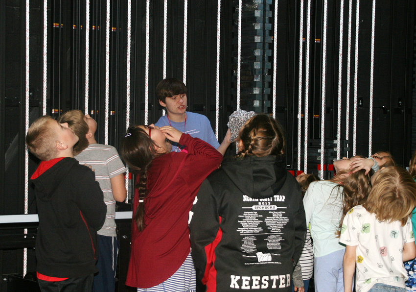 Students get a look at the rigging while Owen Popelka leads a tour of the auditorium.