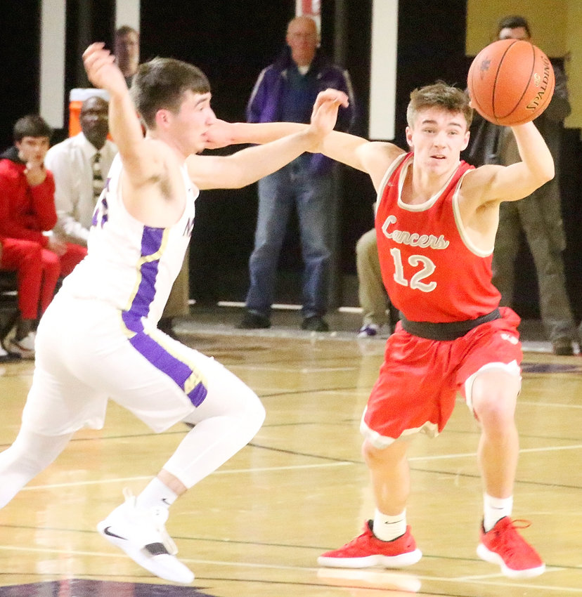Senior Carson Rollinger led the Lancer offensive attack with 15 points against Muscatine on Thursday night. Here he chases down one of his four steals on the defensive end.