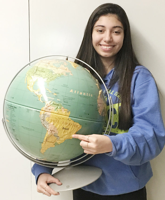 Lavinia Brandao, from Brazil, is living with the Brian and Sheila Fargo family while attending Durant High School as a foreign exchange student. Brandao has embraced the school's extra-curricular activities, including cheerleading and the Durant Dance Team. She's shown above pointing on a globe to her home city of Ipatinga in the Brazilian state of Minas Gerais.
