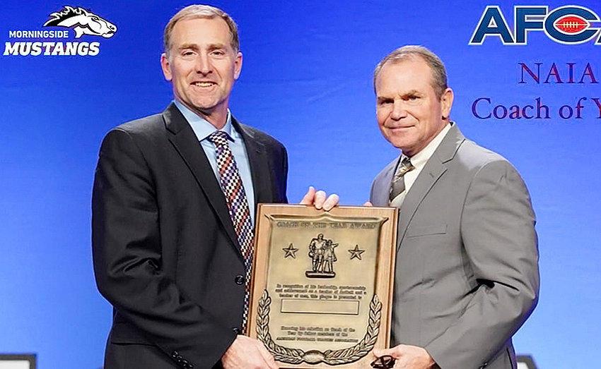 Steve Ryan (l), a 1987 North Scott graduate, was named the NAIA Coach of the Year by the American Football Coaches Association.