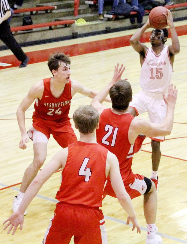 With the game on the line, Lancer senior Tavi Seales converted this 8-foot floater with .8 seconds left to give North Scott a 48-46 win over Assumption.