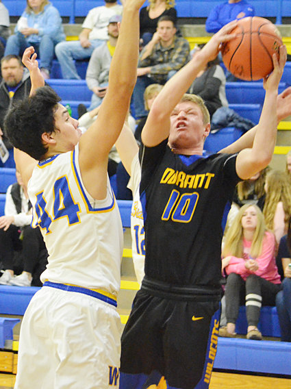 Durant's Bryce Lafrenz battles to get a shot off with Wilton's Ashton Stoelk defending.