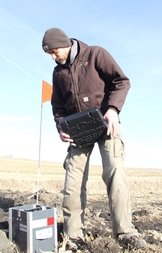 Mike Paustian, of Walcott, checks out a saturated buffer that filters nutrients before they reach a stream.