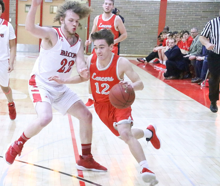With coach Shamus Budde keeping a watchful eye from the sidelines, Lancer senior Carson Rollinger gets a step on Davenport West's John Michael Thornton.