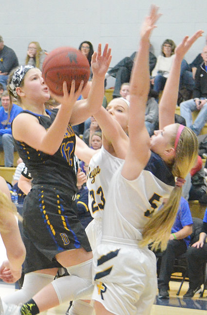 Durant's Kylie Kay tries a scoop shot in the lane at Regina.