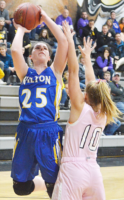 Emily Lange still leads Class 2A in scoring with 23.2 ppg. She had 30 at Tipton.