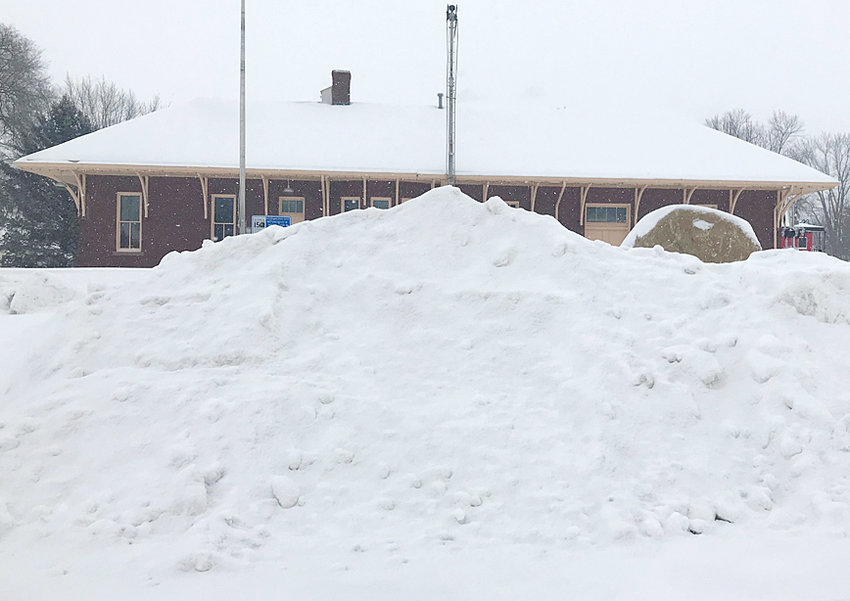 A record 30.2 inches of snow fell in January, including at least four inches on Jan. 31, adding to the large piles of snow throughout downtown Wilton. A large mound of snow is shown above at the end of Maurer Street, nearly blocking the Muscatine County Freedom Rock and historic Wilton Depot from view.