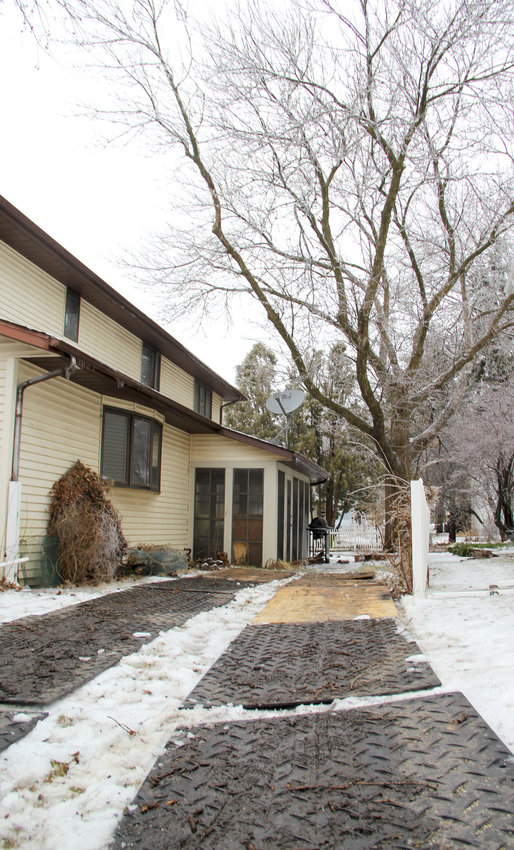 Crews needed mats and plywood to get over ice and snow to the backyard ash tree in the 200 block of South Eighth Street.