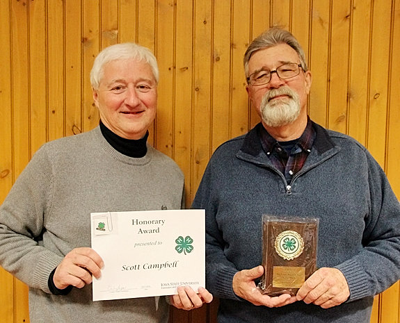 Scott Campbell of The NSP (l) received the Honorary 4-H Award, and Terry Stock, owner of Blue Grass Feed & Seed, was presented the Friend of 4-H Award.
