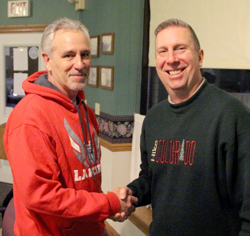 Mayor Michael Limberg congratulates Tony Saladino on his promotion to Public Works Director.