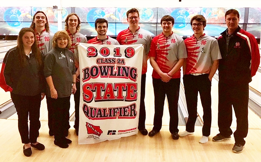 Proudly posing with the state qualifying banner are (l-r) Asst. coach Katelyn Tharp, Garrett Holst, Coach Marie Tharp, Carter Seibert, Brock Larson, Isaac Neymeyer, Alex Isley, Mitch Larson and assistant coach Paul Beadel.