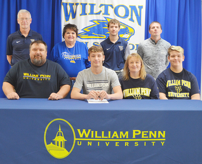 """Wilton High School senior Brock Hartley recently signed a letter of intent to play golf at William Penn University in Oskaloosa. A multi-sport athlete at Wilton, Brock said he's always had a love for golf. """"I thought that would be the right choice,"""" he said, noting he would look to major in either business or sports management. """"He's gotten better each year and his enthusiasm is his best quality,"""" said Wilton head golf coach Nick Dohrmann. """"He's willing to put the work in and he's got the tools."""" Brock is pictured above with (seated) his parents Jason and Heather Hartley, and his brother Briggs. Also pictured include (standing from left) William Penn head golf coach Steve Tucker, Wilton assistant AD Jane Kreimeyer, William Penn graduate assistant Zach Swink and Wilton golf coach Nick Dohrmann."""