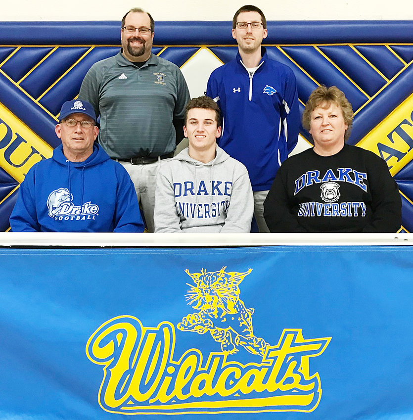 """Durant High School senior Mason Compton recently signed a letter of intent to play football at Drake University in Des Moines. A multi-sport athlete at Durant, football is where Compton truly shined, ranking in the top 15 in Iowa history with 2,540 career receiving yards, and top 30 in career receptions (146) and touchdown receptions (25). He caught 50 balls for 996 yards and 12 touchdowns during his senior year. At Drake, he'll likely be a defensive back but said he hopes to get a shot at playing receiver. """"I would love to play receiver but I just want to get on the field,"""" Mason said. """"I'm excited to get into a full program to see what my body can develop into. I'm going to get the best education I can and get to play Division I football so that's the best of both worlds for me."""" Mason will major in business management at Drake and is pictured above with (seated) his parents Tom and Sheila Compton, and (standing from left) head Durant football coach Joel Diederichs and Activities Director Matt Straube."""