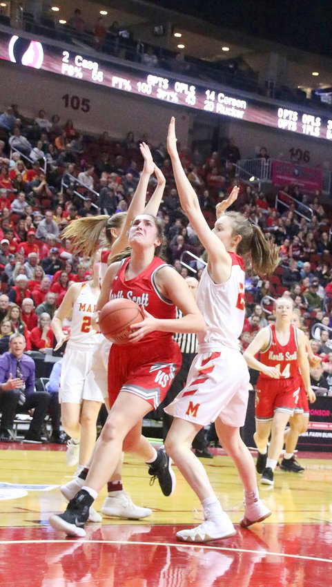 """Lancer junior Grace Boffeli was unstoppable on her way to 21 first-half points. The Indians tried everything, but as evidenced by this drive, even two Indians were no match for the 6'2"""" Boo."""