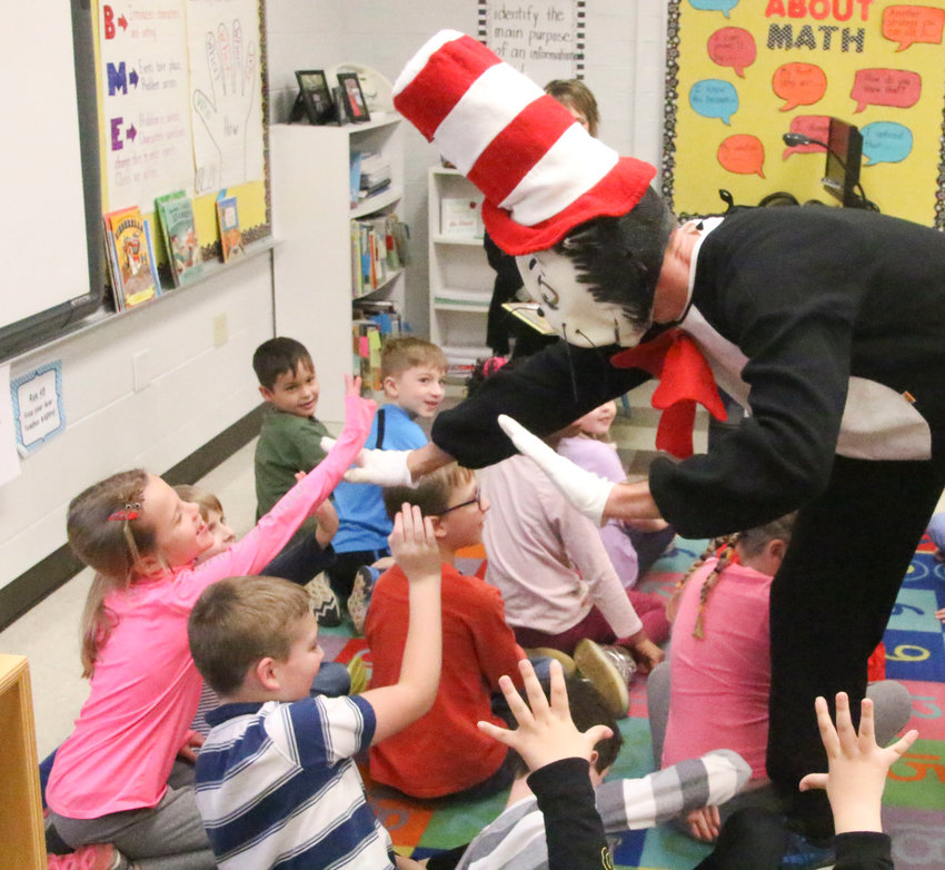 The Cat in the Hat greets students.