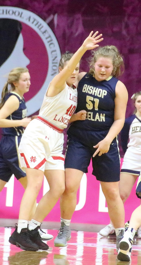 After Heelan's Ella Skinner scored 13 first-half points, Lancer junior Adriane Latham was tenacious on defense and held her to zero the rest of the way.