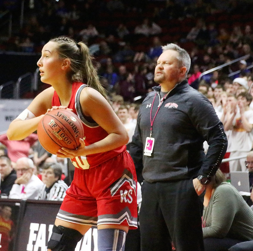 With coach TJ Case looking on, Rylie Rucker eyes an open teammate.