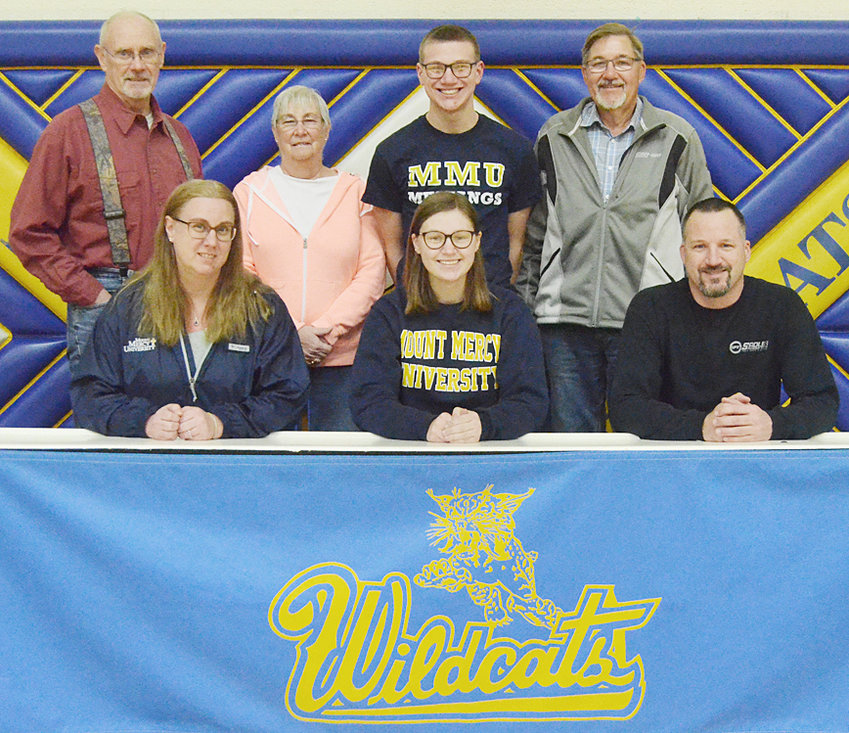 """Durant senior Kerrigan Johnson recently signed a letter of intent to bowl at Mount Mercy University in Cedar Rapids. """"The reason I chose Mount Mercy was because of the academics that I could receive there. Bowling was just an excellent addition to the college that would help me be able to continue my athletics,"""" said Kerrigan. Johnson plans to major in nursing with a minor in Spanish. She's pictured above with her parents Corrie and Kevin Johnson (seated); and (back row from left) grandparents Lynn and Joyce Keller, brother Kayden Johnson and grandfather Monte Johnson."""