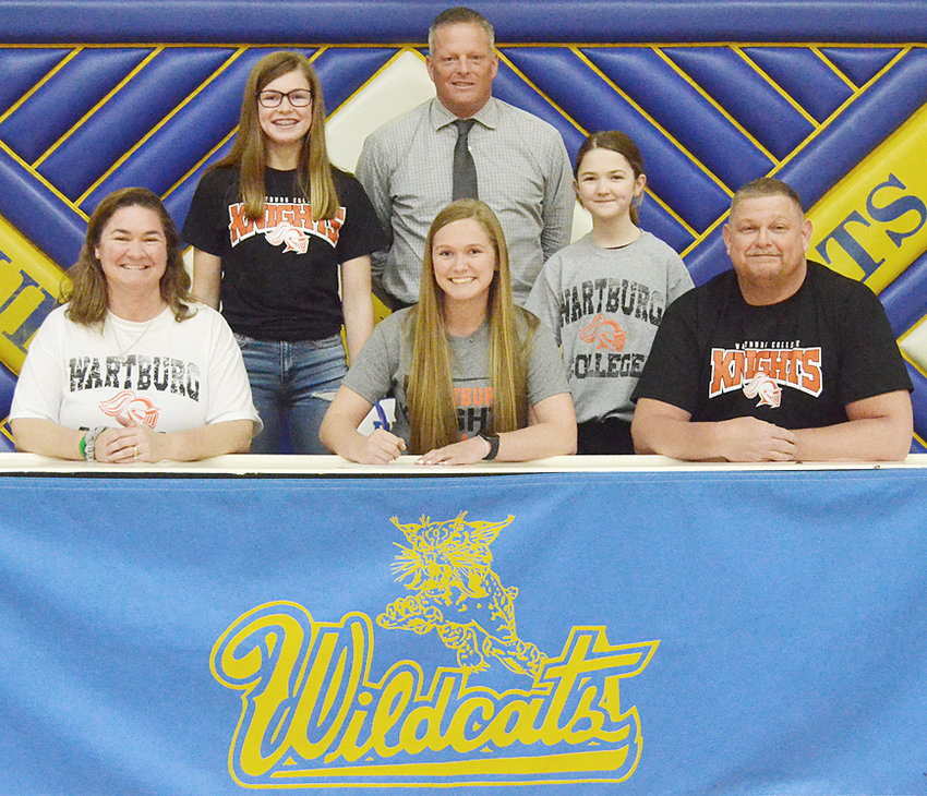 """Durant senior Hannah Happ recently signed a letter of intent to play softball at Wartburg College in Waverly. Happ was also visiting other schools but said that on her third trip to Wartburg, """"it felt like home."""" A utility player, Happ said that she'd be willing to play anywhere for a team that will be losing eight seniors this season. Academically, she plans to major in biology while working toward becoming an occupational therapist. Happ still has one more year with the Durant Wildcats and the goals will be big for last year's No. 1 ranked team. """"We have high expectations with three goals: a conference championship, making state and a state title,"""" Hannah said. She's pictured above with her parents Kristal and Nick Happ (seated); and (back row from left) sister Ally Happ, Durant new head softball coach Kevin Kaalberg and sister Paige Happ."""