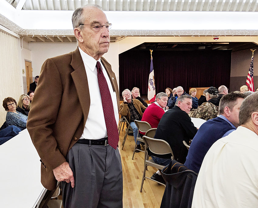 U.S. Senator Chuck Grassley (R-Iowa) is shown interacting with a crowd in Durant during the question-and-answer portion of a Cedar County town hall meeting March 21.