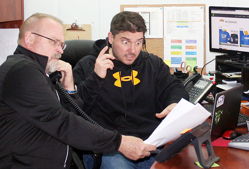 Wilton High School Alumni Association president Ted Marolf (left) and Joe Brammeier are shown fielding calls for the final tickets to this year's Wilton Alumni Banquet April 6 at the community center. Brammeier will serve as the event's emcee for the second straight year, with several entertaining events planned.